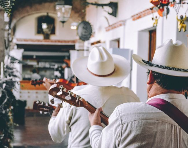 Mexican mariachi Mariachi EyeEm Selects Music Musical Instrument String Instrument Rear View Hat Arts Culture And Entertainment People Focus On Foreground Men Musical Equipment Clothing Playing Guitar Lifestyles Real People Musician Indoors  Adult A New Perspective On Life
