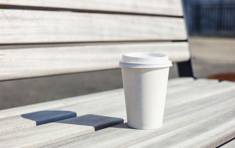 Close-Up Of Disposable Cup On Bench