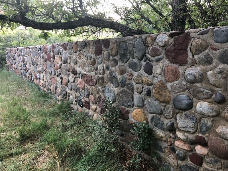 Hand built stone wall EyeEmNewHere Handbuilt Wall - Building Feature Wall Tree Muti Colored Pioneer Building Barn Foundation Stone Wall Concrete EyeEmNewHere
