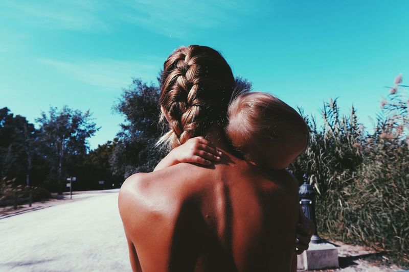 MOTHER LOVE Young Adult Lifestyles Long Hair Sky Person Human Hair Sunny Beauty Outdoors Nature Beauty In Nature tTree rRelaxationtTranquil ScenedDaycCloudhHuman FacesScenicsdDomestic LifecCarefreeeEmbracing