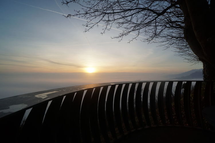 View of railing against sky during sunset