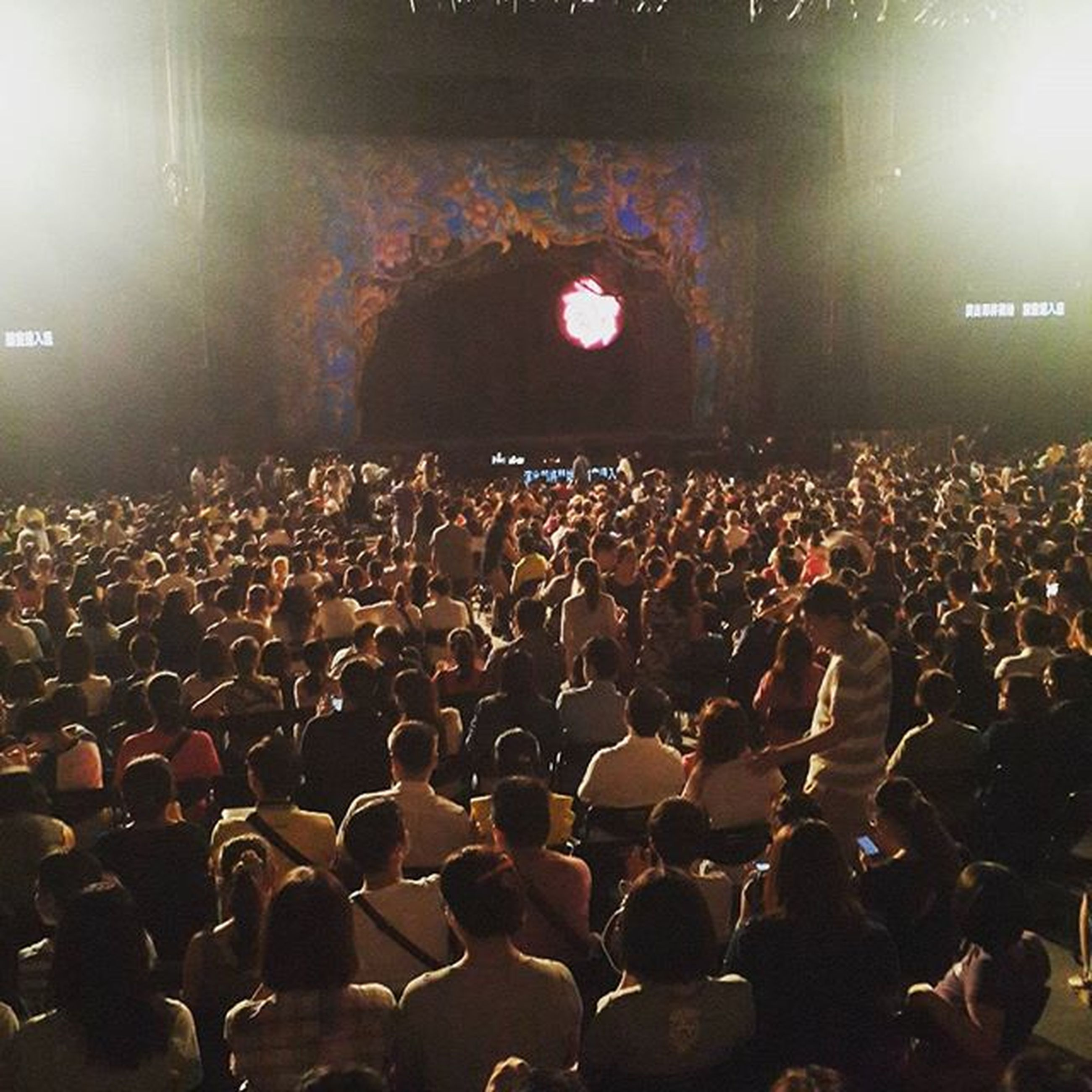 indoors, large group of people, illuminated, crowd, lifestyles, men, person, night, lighting equipment, leisure activity, arts culture and entertainment, light - natural phenomenon, music, nightlife, togetherness, stage - performance space, performance, event