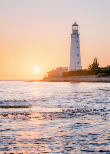 Lighthouse Sunset Beach Landscape Sky Business Finance And Industry Sea Direction Outdoors Tranquil Scene Illuminated Building Exterior Tranquility Silhouette Travel Destinations Horizon Architecture Horizon Over Water Scenics Water