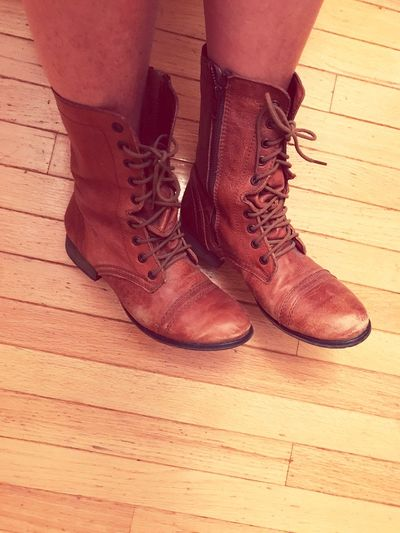 Leather Boots Shoe Low Section Indoors  Hardwood Floor Brown Human Body Part Human Leg High Angle View One Person Close-up Lifestyles Real People Boots People Boot Distressed Worn In Style Boots On  Brown Boots Fashion NewToEyeEm These Boots Are Made For Walking