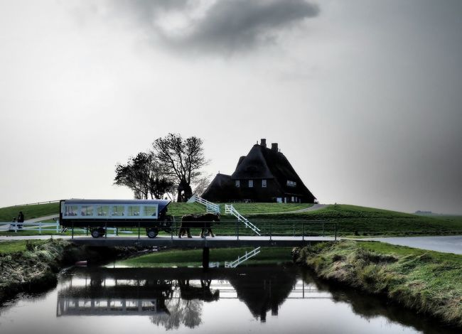 Hallig highlight Church Schleswig-Holstein Architecture Building Exterior Built Structure Carriage Day Euro Germany Hallig Hoogelaand Horse Nature No People Outdoors Sky Transportation Tree Warft Water Waterfront