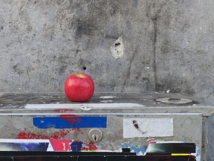 apple store Apple Left Over Close-up Day Electricity Cupboard Fruit Keyhole No People Red Stone Wall Streetphotography