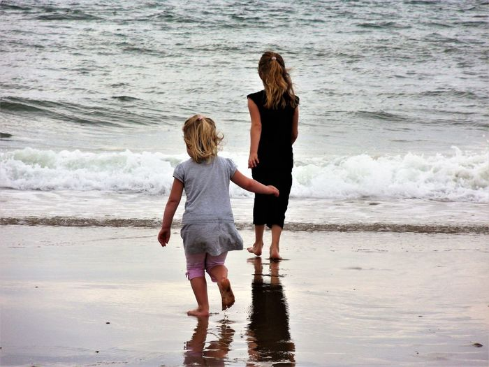Water Beach Sea Family Childhood Togetherness Rear View Wave Leisure Activity Positive Emotion EyeEmNewHere Sand Sisters