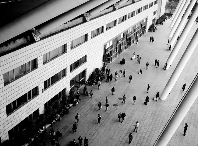 Commuters outside Guangzhou South Station Bnw Black & White Blackandwhite Architecture Large Crowd Walking People Outdoors High Angle View Lifestyles Crowd City Day