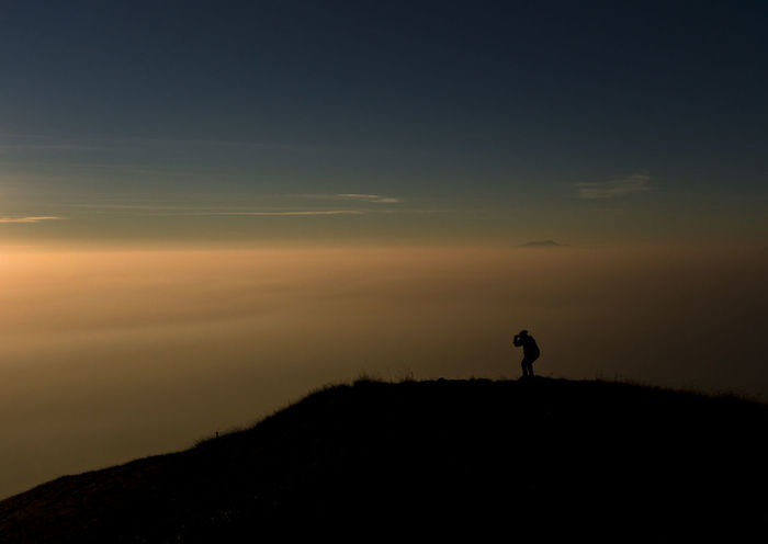 Silhoutte Beauty In Nature Day Full Length Hiking Landscape Leisure Activity Lifestyles Men Nature One Person Outdoors People Real People Scenics Silhouette Sky Standing Sunset Tranquil Scene Tranquility Walking