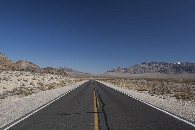 Road In Desert Against Clear Sky