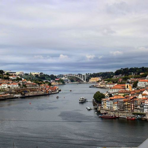 The contrast we've always had. And the bridge we've never been able to build. River City Douro  Water Cityscape Outdoors Architecture City Cloud - Sky Day