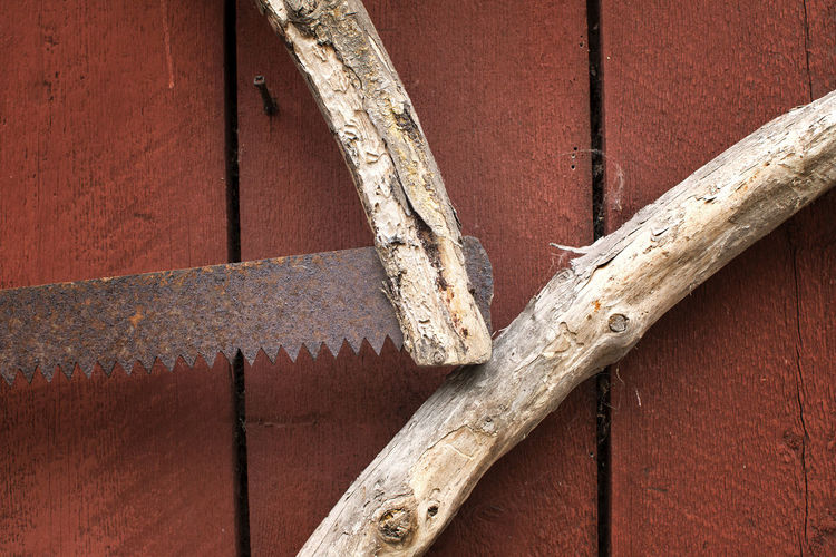 Handmade saw Red Architecture Backgrounds Blade Brown Close-up Day Focus On Foreground Full Frame Handle Handmade Handsaw Metal Nature No People Old Outdoors Pattern Rusty Rusty Metal Saw Vintage Weathered Wood - Material Analogue Sound