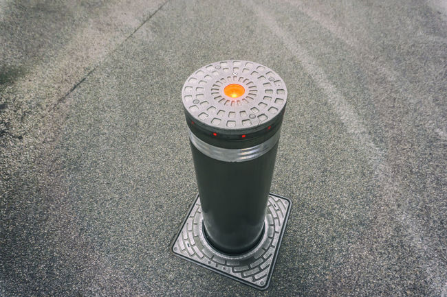 Automatic rising bollard preventing vehicular access in Berlin, Germany Access Bollard Flashing Lights Horizontal Metal No People Rising Robust Technology Vehicular