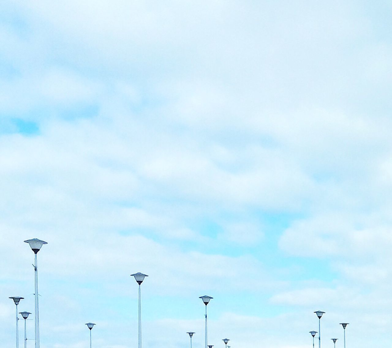 low angle view, cloud - sky, sky, day, street light, no people, outdoors, technology, nature