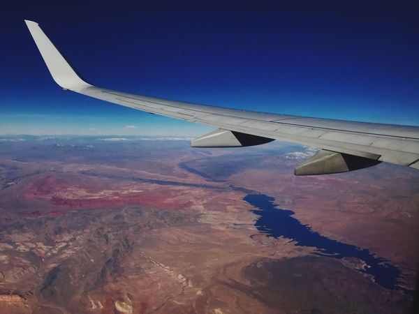 Flying high Airplane Aircraft Wing Aerial View Flying Transportation Landscape Travel Sky No People Nature Cloud - Sky Airplane Wing Tranquil Scene Scenics Outdoors Day Beauty In Nature EyeEmNewHere Phone Photography Window Seat Airplane Wing Aerial Photography Drone View Flying High