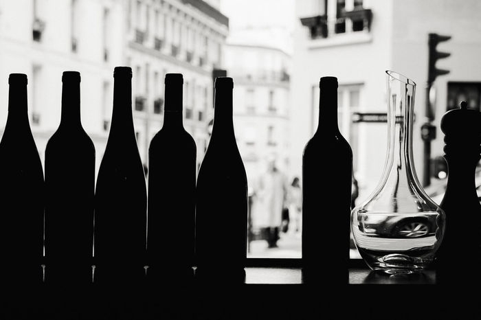 Un moment. Alcohol Bottle Café Parisien Close-up Day Drink Focus On Foreground Food And Drink France Indoors  No People Paris Streets Parisian Life Wine Wine Bottle Wineglass