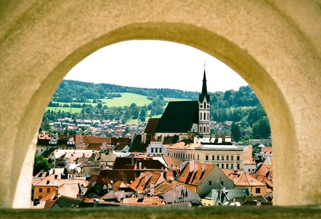 Cesky Krumlov through the window Travel Photography Travel 35mm Film 35mm Film Photography Film Vintage Old Fairytale  European  Europe Trip Europe Český Krumlov Czech Republic Architecture Built Structure Building Exterior Town Day Arch No People Outdoors City Sunlight Tree Cityscape Roof Clear Sky Sky Nature EyeEmNewHere EyeEmNewHere