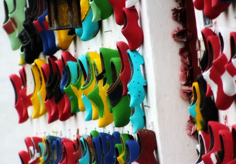 Full frame shot of multi colored clogs hanging at market stall