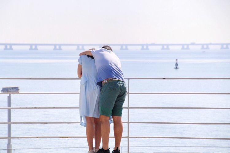 Rear View Of Couple Hugging