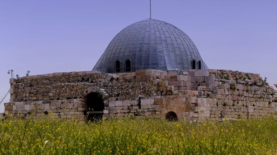 Umayyad Palace🇯🇴 Umayyad Palace. Amman Citadel Ancient Civilization Architecture Building Building Exterior Built Structure Clear Sky Day Dome Field Flower Growth History Nature No People Outdoors Place Of Worship Plant Religion Sky The Past Tourism Travel Travel Destinations