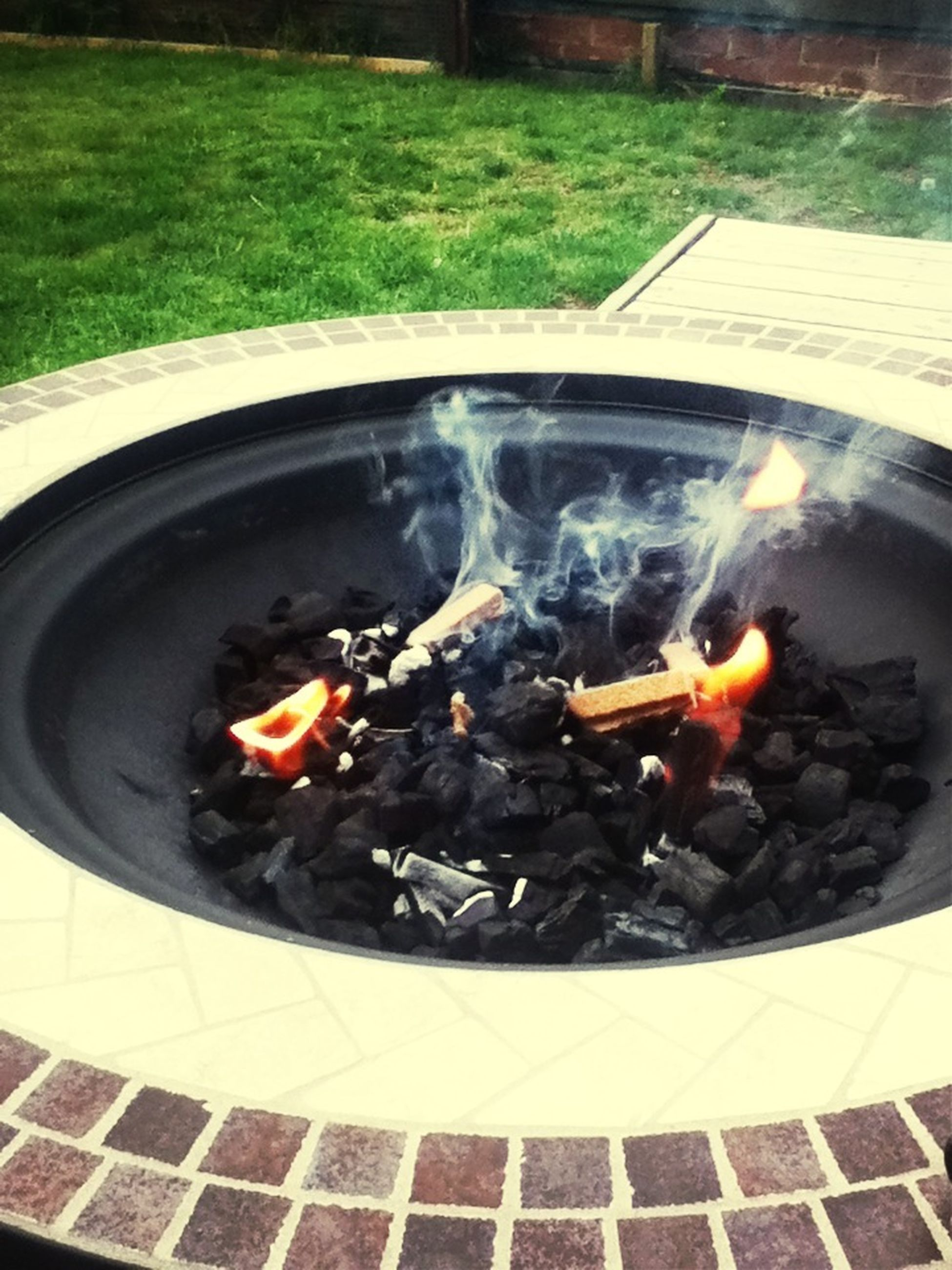 burning, flame, heat - temperature, fire - natural phenomenon, food and drink, preparation, cooking, high angle view, food, freshness, cooking pan, close-up, fire, motion, smoke - physical structure, indoors, barbecue, preparing food, barbecue grill, stove