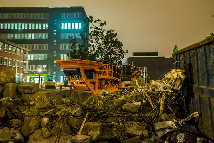 Bulldozer against built structure