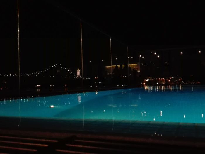 The city by night! Swimming Pool Bridge - Man Made Structure Water Illuminated City Sky