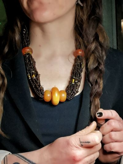 Close-up of woman with amber necklace etsy selling