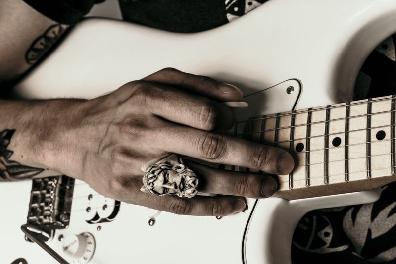 Human Hand One Person Hand Playing Guitar Musical Instrument String Instrument Real People Music Musical Equipment Human Body Part Arts Culture And Entertainment Lifestyles Musician Musical Instrument String Close-up