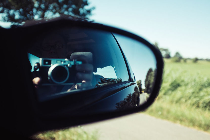 Road Trip Car Day Focus On Foreground Land Vehicle Mirror Mode Of Transportation Motor Vehicle Nature on the move One Person Outdoors Photography Themes Plant Reflection Road Road Trip Side-view Mirror Sky Technology Transportation Tree Vehicle Mirror X100f