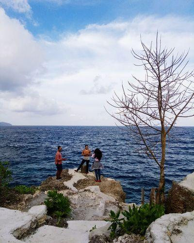 Nature Ambonmanise Molucas Latuhalat AmbonIsland Water Sea Working Men Full Length Fisherman Occupation Standing Fishing Togetherness