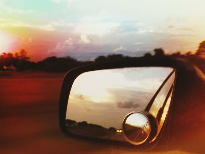 Reflection of sun on side-view mirror