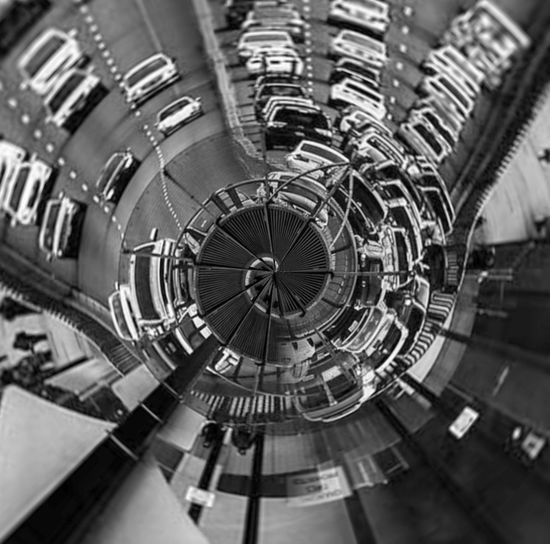 Close-up of ferris wheel in city