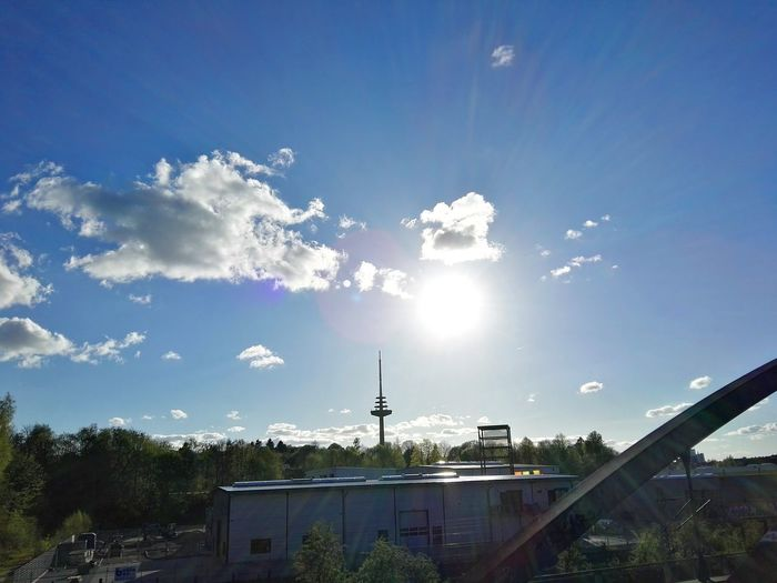 Check This Out the Sun over the Broadcasting Tower of Kiel Landeshauptstadt Kiel Outdoors Cloud - Sky Sky Tree Nature Eye4photography  The Great Outdoors - 2017 EyeEm Awards The Purist (no Edit, No Filter) The Architect - 2017 EyeEm Awards Sunlight Sunbeam Cityscape Sunshine No People Day Travel Destinations Modern Workplace Culture