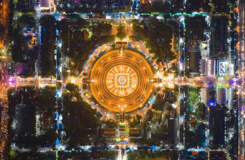 Aerial view of illuminated temple in city at night