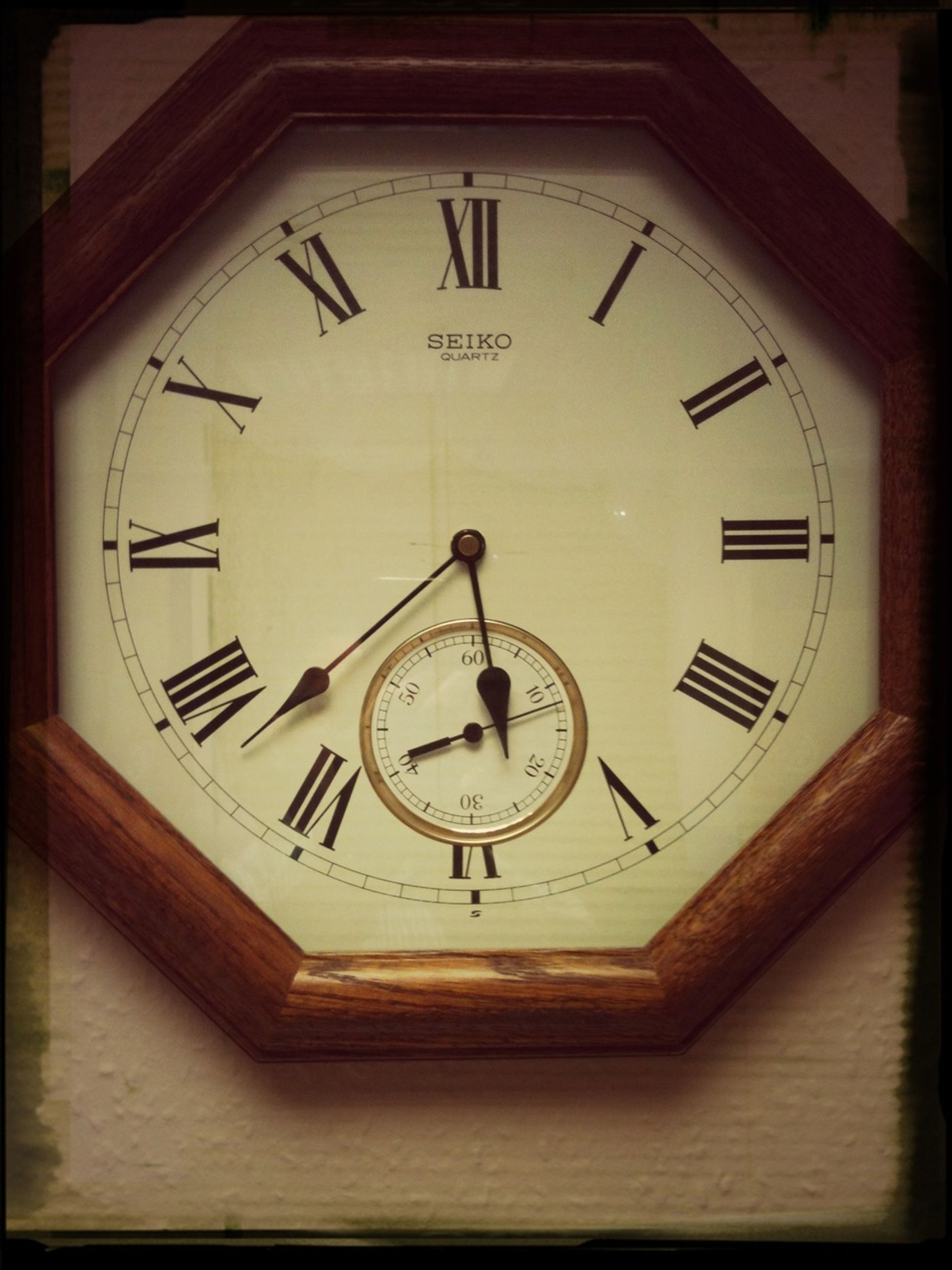 clock, time, indoors, communication, number, clock face, text, instrument of time, wall clock, close-up, minute hand, accuracy, circle, roman numeral, technology, western script, old-fashioned, single object, no people, low angle view