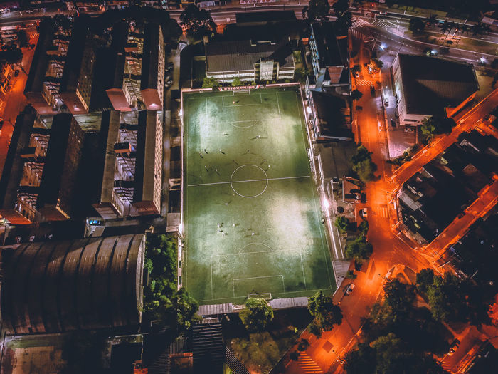 High angle view of playing field in city at night