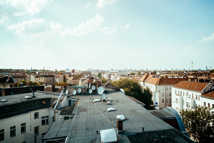 Over the roofs Berlin Love City Cityscape Roof Rooftop Urban Geometry Architecture Berliner Ansichten Building Building Exterior Built Structure City City View  Cityscape Cloud - Sky Day High Angle View House Outdoors Residential District Roof Sky Sunlight Urban Urban Skyline