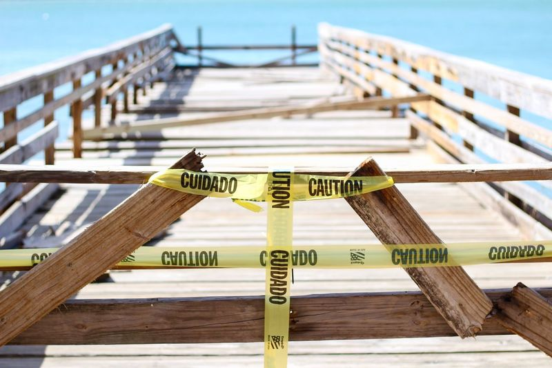 Close-Up Of Cordon Tape On Wooden Pier