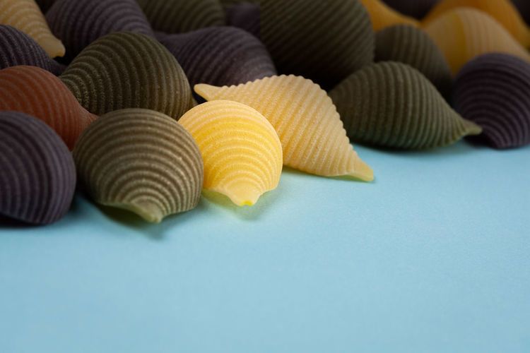 Directly above shot of uncooked pasta on blue background