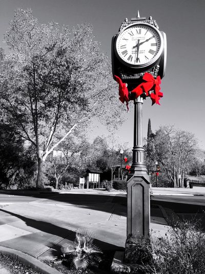 """""""Red Bows At Christmas Time"""" Bright red Christmas bows adorn the Clayton Town clock and adjacent area in the small town of Clayton, California, USA. Red Bows Clock Tower Christmastime Christmas Decorations Small Town Bows Clock California Holidays"""