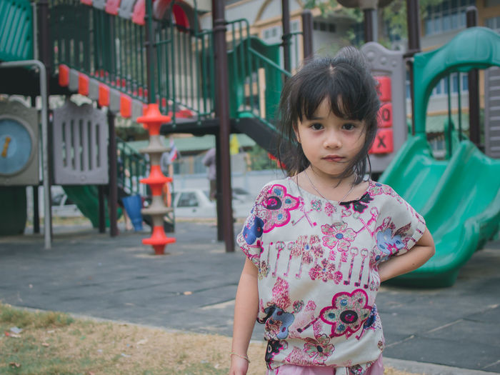 Cute little girl post at a playground Innocence Outdoors Child Girl Smiling Lifestyles Fun Outside Playground Little Girl Cute Park Activity Asian  person Portrait Playful Summer Asorable Healthy Young Enjoying Life