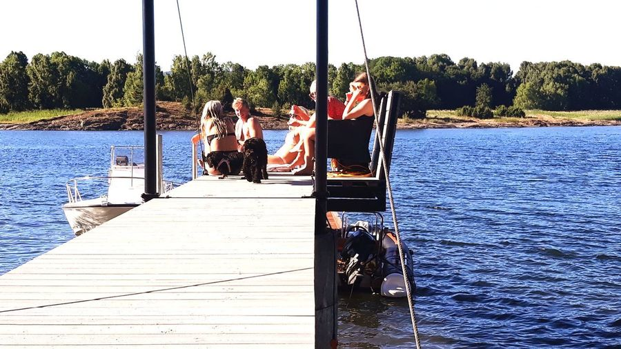 Summertime. Snarøya, Norway Water Friendship Young Women Bonding Togetherness Men Full Length Sitting Women Paddleboarding Boat Deck Boat