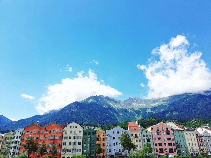 INNSBRUCK, AUSTRIA - JUNE 27, 2018 : view of colorful houses in Innsbruck city along side the river with Alpes mountain on background Colorful Summer Summertime Alpes Mountains House Europe Trip Tourism Tourism Destination Tourist Attraction  Scenics Landscape Outdoors Landmark Rippled European Alps City Cityscape Mountain Tree Blue Sky Architecture Mountain Range Building Exterior Built Structure TOWNSCAPE Urban Skyline Town Snow Covered