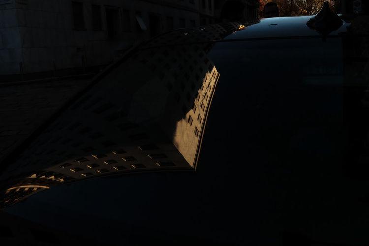 Close-up of illuminated lamp in city