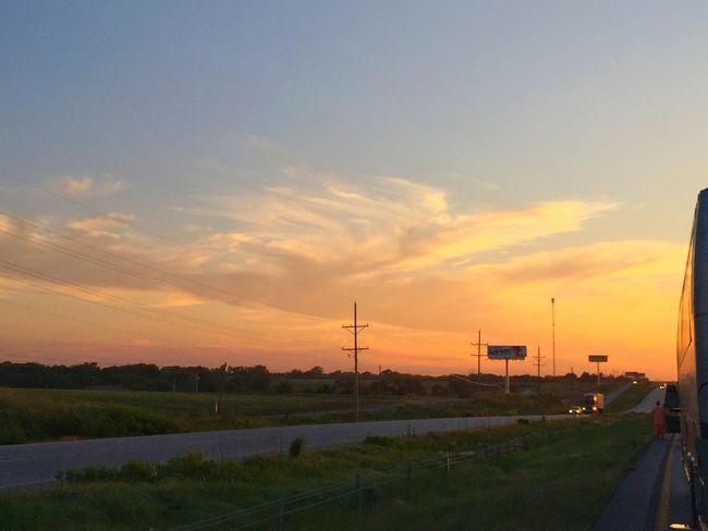 Road trip driving interstate midwest United States america summer fields clouds landscape road traveling vacation sunset sky truck