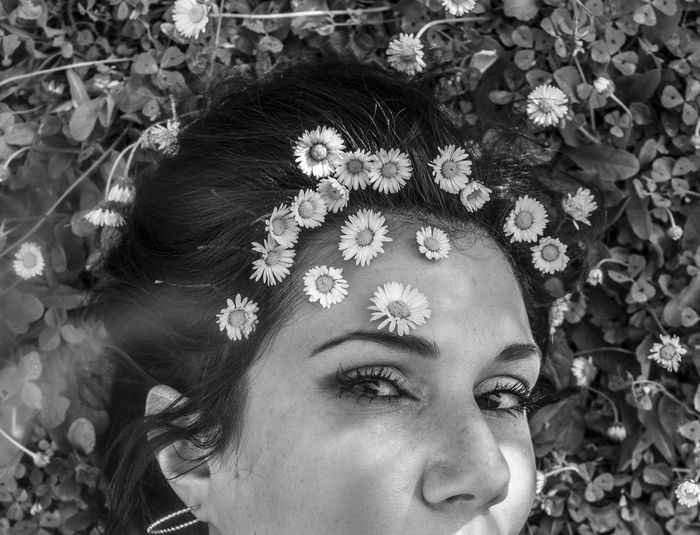 Close-up portrait of woman wearing flowers
