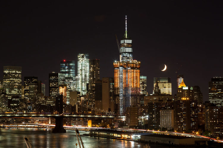 Brooklyn Bridge / New York Cityscape Manhattan Moon Sickle NYC Sightseeing Skyline Architecture Attraction Building Building Exterior City Financial District  Illuminated Long Exposure Modern Night Office Building Exterior Tourism Travel Destinations Urban Skyline World Trade Center One