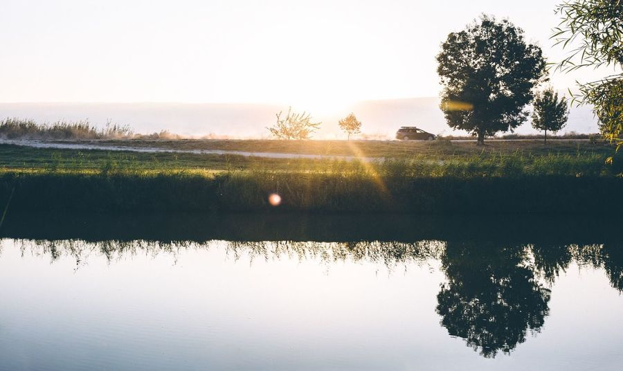 Weekend vibes Reflection Tree Tranquil Scene Sunset Nature Scenics Beauty In Nature Tranquility Silhouette Water No People Lake Sky Outdoors Idyllic Sun Sunlight Landscape Day Clear Sky Connected By Travel Perspectives On Nature
