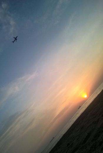 Beach Sky Sunset Beauty In Nature Cloud - Sky Flying Scenics - Nature Airplane Sea Tranquility